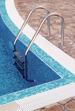 Corner of a swimming pool Stock Photos