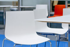 Corner of table. And white plastic chair in common room in the open space office Stock Photography