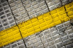 Corner to corner. Yellow painted mark on the street pavement Royalty Free Stock Image