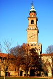 Corner tower and bell tower in the courtyard of the castle of Vigevano near Pavia in Lombardy (Italy) Royalty Free Stock Photos
