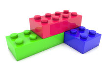 Corner of toy bricks in three colors Stock Images