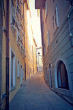 Corner of Trieste old town. Trieste, Italy - Old town, narrow pedestrian street in the ghetto in back light Royalty Free Stock Photos