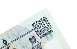 Corner of Twenty Mexican Pesos. Close-up of 20 Mexican pesos isolated on a white background Royalty Free Stock Photo