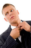 Corner view of businessman tucking his button Royalty Free Stock Photo