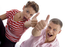 Corner view of couple with thumbs up. With white background Stock Photography