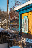 Corner of village house. In sunny winter day Stock Photo