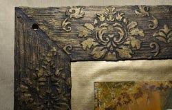 Corner of a vintage dark-gold photo frame. Corner of a handmade vintage dark-gold photo frame with floral pattern Stock Photography