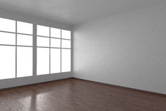 Corner of white empty room with windows and dark floor Stock Photo