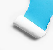 Corner white torn paper with blue background Royalty Free Stock Images