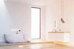 Corner of a white walls bathroom, toned Royalty Free Stock Images