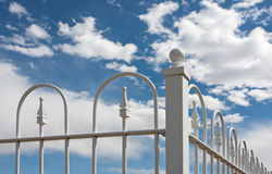 Corner of White Wrought Iron Fence Stock Images