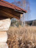 Corner of a wooden hut. With a view of the nature Stock Image