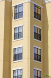 Corner of Yellow Stucco Condo Building Royalty Free Stock Image