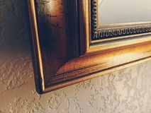 Cornered. Corner of a painting frame with weathered detail Stock Image