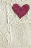 Cornered red heart. Hand made pressed rice paper with  red cornered heart Royalty Free Stock Photos