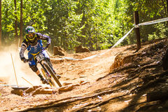 Cornering during downhill race Stock Photo