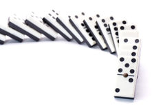 Cornering fallen domino Royalty Free Stock Image