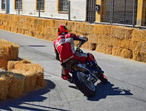 Cornering On A Motorcycle. A racer takes a tight bend during the Algueña motorcycle race in Spain royalty free stock photography