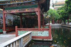 Corners of Chinese classical gardens. Pavilions, goldfish ponds, wooden pavilions, long corridors, ancient stone tables, stone stools stock photography