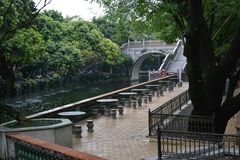 Corners of Chinese classical gardens. Pavilions, goldfish ponds, wooden pavilions, long corridors, ancient stone tables, stone stools stock photo