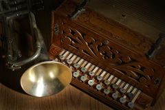Cornet and accordian. Old accordian and cornet stock photo