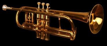 Cornet on black. Brass cornet at slight angle on black background with clipping path Royalty Free Stock Image