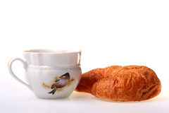 Cornetto. On a saucer with a cup of black tea Royalty Free Stock Photo