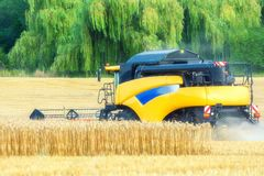 Farmer is harvesting crops with a combine harvester royalty free stock photography