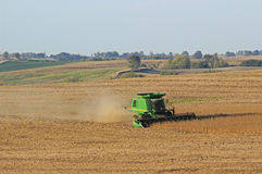 Cornfield Harvest. Combining corn field at harvest time stock photography