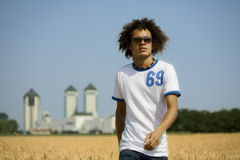 Cornfield02. Cool guy walking in a cornfield royalty free stock photos