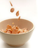 Cornflakes. Pouring cornflake into a bowl royalty free stock images