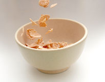 Cornflakes. Pouring cornflake into a bowl stock images