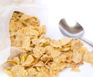 Cornflakes. Crunchy cornflakes on white background royalty free stock photo