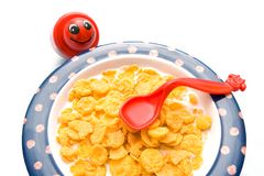 Cornflakes. Kids bowl with cornflake and milk Stock Photos