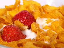 Cornflakes. And Strawberries with milk for breakfast - morning meal Stock Images