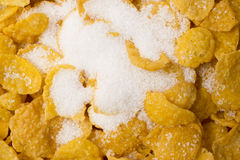 Cornflakes with added sugar. A close of of cornflakes with added sugar stock images