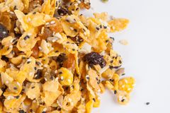 Cornflakes with almond, honey, sesame and dried fruits Stock Photography
