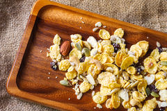 Cornflakes with almond, honey, sesame and dried fruits Royalty Free Stock Image