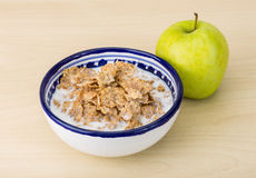 Cornflakes and apple Royalty Free Stock Image