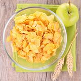 Cornflakes and apple Stock Images
