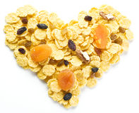 Cornflakes arranged in the shape of heart. Stock Images
