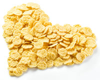 Cornflakes arranged in the shape of heart. Stock Image