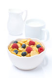 Cornflakes with berries and fresh milk, isolated. On white Stock Photo