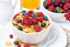 Cornflakes with berries, milk and orange juice Stock Photo