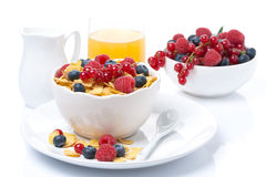 Cornflakes with berries, milk and orange juice Royalty Free Stock Photo
