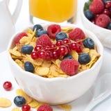 Cornflakes with berries, milk and orange juice Stock Images