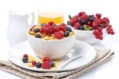 Cornflakes with berries, milk, orange juice Royalty Free Stock Photos