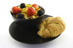 Cornflakes in a Black Bowl with a Croissant Royalty Free Stock Photos