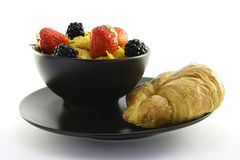 Cornflakes in a Black Bowl with a Croissant Stock Photography