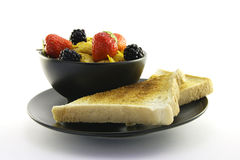 Cornflakes in a Black Bowl with Toast Stock Photography
